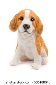 Decorative puppy/dog. Children's rooms, interior, garden decor. Ceramic statue, isolated on white background. Front, side view. Closeup.