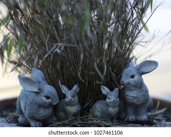 decorative rabbits family in front of grass waiting for easter holiday
