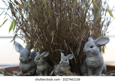 decorative rabbits family in front of grass waiting for easter holiday traditional season decoration