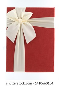 Decorative red gift box with ribbon on white background, Top view