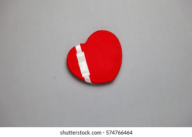 Decorative red heart on a grey background. Valentine heart. Saint Valentine's Day or Love concept.