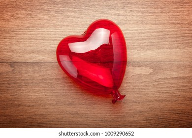 Decorative red heart on rustic wooden background