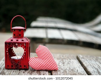 Decorative red metal lantern with a heart