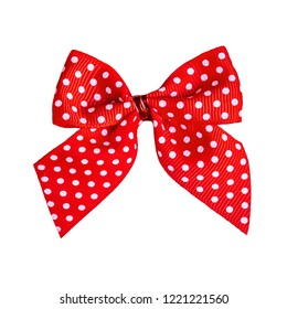 Decorative Red ribbon bow with  white polka dot  pattern isolated on white background