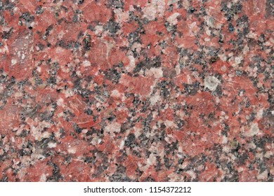 Decorative red stone wall texture for background.