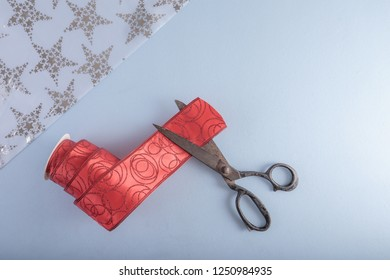 Decorative ribbon and old tailor's scissors. Christmas craft supplies.