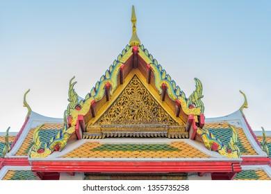 A decorative roof at Wat Arun Ratchawararam Ratchawaramahawihan temple in Bangkok, Thailand.