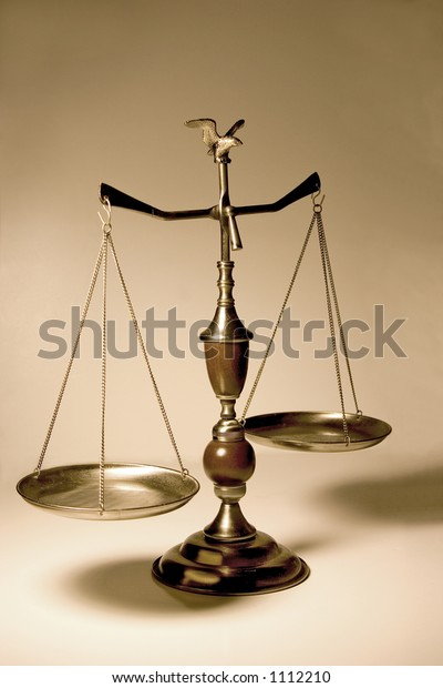 Decorative scale / balance with wooden accents and an eagle on top.  Bronze background.