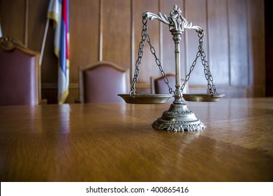 Decorative Scales of Justice on the table. Focus on the scales