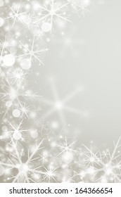 Decorative silver christmas background with bokeh lights and snowflakes