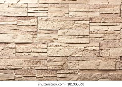 Decorative slate beige stone wall pattern, background.