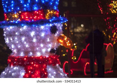 Decorative snowman with lights and shiny Christmas decorations