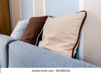 Decorative soft modern pastel color pillows on the sofa