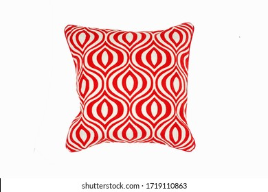 Decorative soft pillow, with geometric pattern in red and white color, isolated on white background