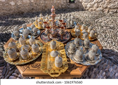 Decorative souvenirs and handicrafts in the Old Town of Mostar in arabic style - Copperware, beaded decorated cans, tea caraffe, silver and golden ornamented plates, Mostar, Bosnia and Herzegovina