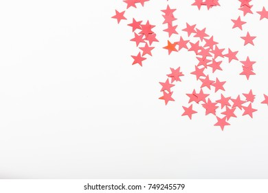Decorative stars in red color on white background, closeup holiday season detail