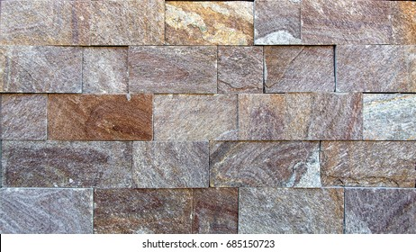 Decorative stone background, texture of a stone for decorating of facades of buildings and internal walls.
