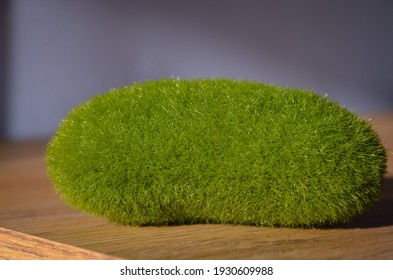 Decorative stone from a green moss