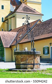 Decorative stone well in the yard of the  Stainz Castle