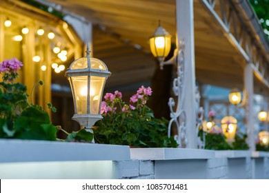 decorative street lamps decorating a summer terrace with forged elements
