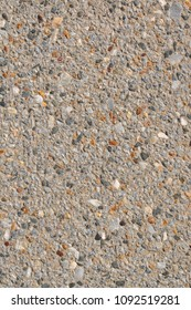 Decorative surface made from small stones. Irregular stone surface for background, texture use