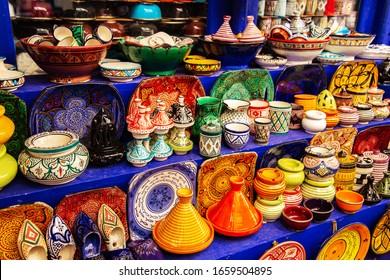 Decorative Tajines at a market in Marrakech. Moroccan design. Oriental souvenirs.