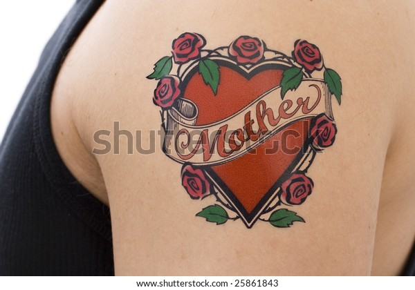 "Decorative tattoo on a male arm featuring the word ""Mother"" on a scroll overlaying a red heart surrounded by pink roses with green leaves."