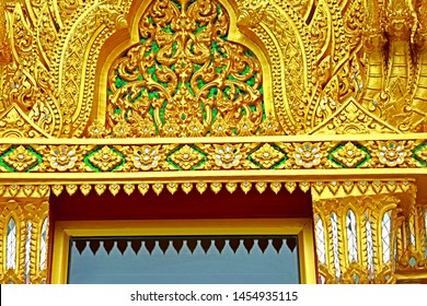 Decorative Thai style golden stucco on the roof & the wall of Church in Thai temple