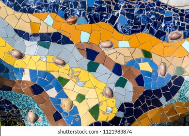Decorative tile-shard mosaic in Parc Guell, Barcelona, Spain