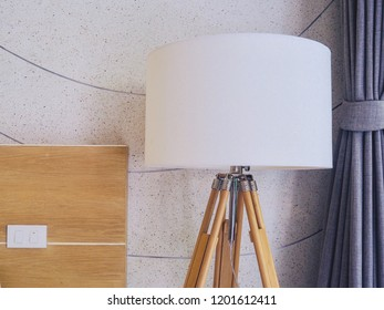 Decorative tripods floor lamp in modern style room. White standing light with wood tripods.