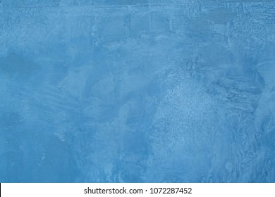 decorative turquoise wall plaster background. Rough stylized texture