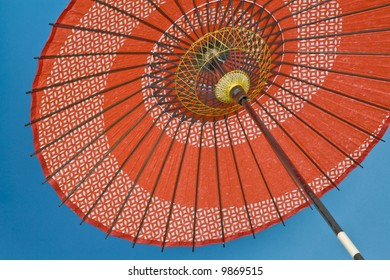A decorative umbrella characteristic of various Asian cultures.