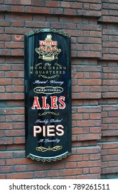 Decorative vintage advertising sign for the pub Fuller's Ale and Pie House - London, Great Britain - 08/04/2015