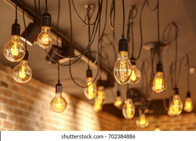 Decorative vintage bulbs of Edison opposite to a brick wall