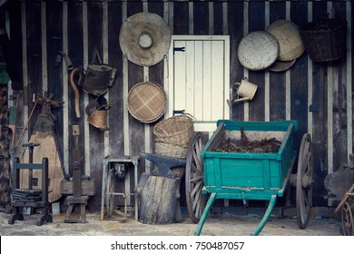 Decorative vintage wooden car wagon and farm objects hanging on the wall - Serra Gaúcha, Rio Grande do Sul, Brazil.