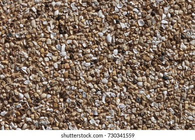 Decorative wall with beautiful rough brown and white stone ,Concrete stone wall texture for background and wallpaper