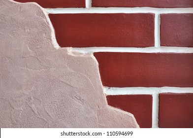 Decorative wall with left stucco right brickwork