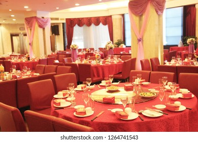 A decorative wedding banquet main table setting.