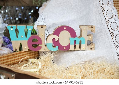 """Decorative welcome sign """"Welcome"""" close up. Wooden letters."""