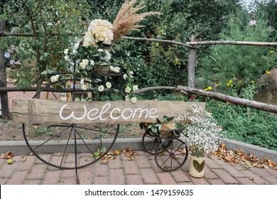 """Decorative welcome sign """"Welcome"""" close up. Flower decoration."""