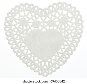 Decorative White Heart Doilie Isolated on White with a Clipping Path.