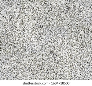 decorative white ornamental gravel texture background in top view