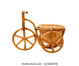 Decorative wicker tricycles bike from the vine isolated on a white background