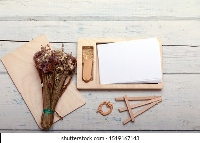 Decorative wooden box for wedding or newborn photo with memory sticks. Ecological friendly package for wrapping. Empty photo balnk for text or other. Rustic vintage styl with copyspce. - Shutterstock ID 1519167143
