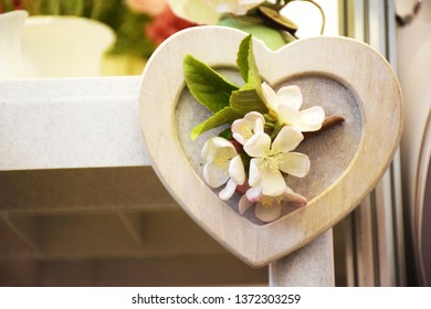 Decorative wooden heart with apple flowers. Original gift or decoration for Easter, Mother's Day, St. Valentine's Day.