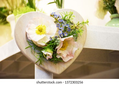 Decorative wooden heart with poppies flowers. Original gift or decoration for Easter, Mother's Day, St. Valentine's Day.