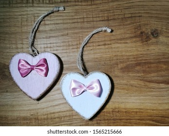 Decorative wooden hearts on old wooden background.Two Valentine hearts. Saint Valentine's Day or Love concept.