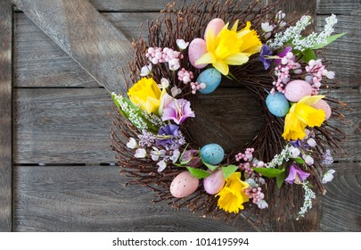 Decorative wreath made from twigs and flowers for easter
