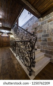 Decorative wrought iron on staircases with stone wall