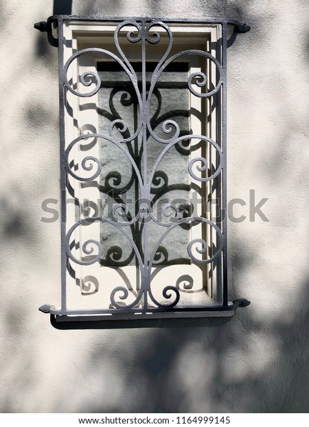 Decorative Wrought Iron Window Bars On Objects Stock Image